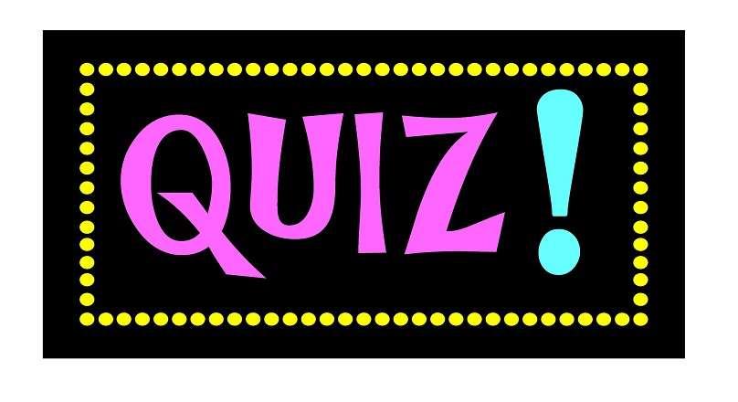 Skylt med ordet Quiz i rosa mot svart bakgrund